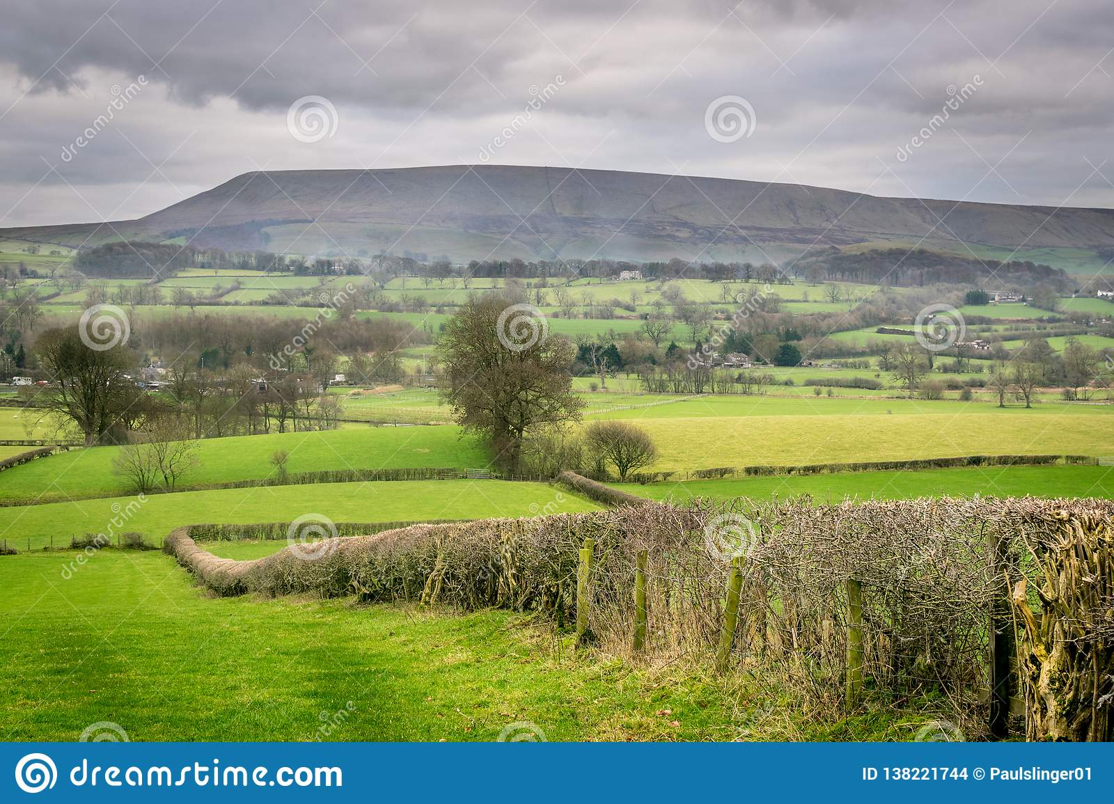 Pendle Hill In The Distance In The Ribble Valley On A