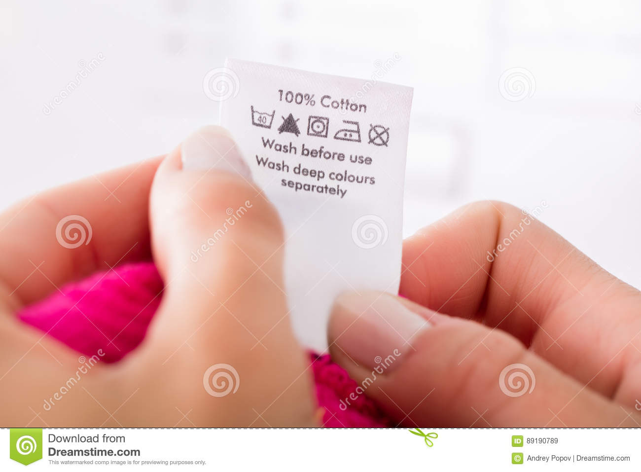 Person Reading The Clothing Label Stock Image