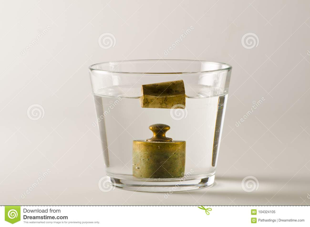 Physics Heavy And Light Objects In Water Stock Image