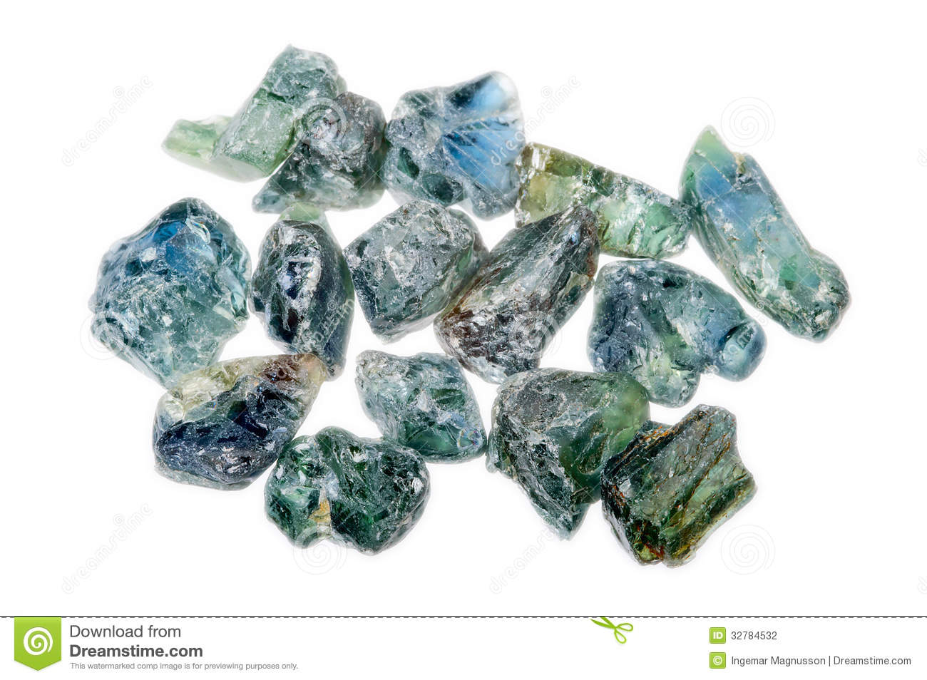 A Pile Of Rough Uncut Light Blue Green Sapphires Stock