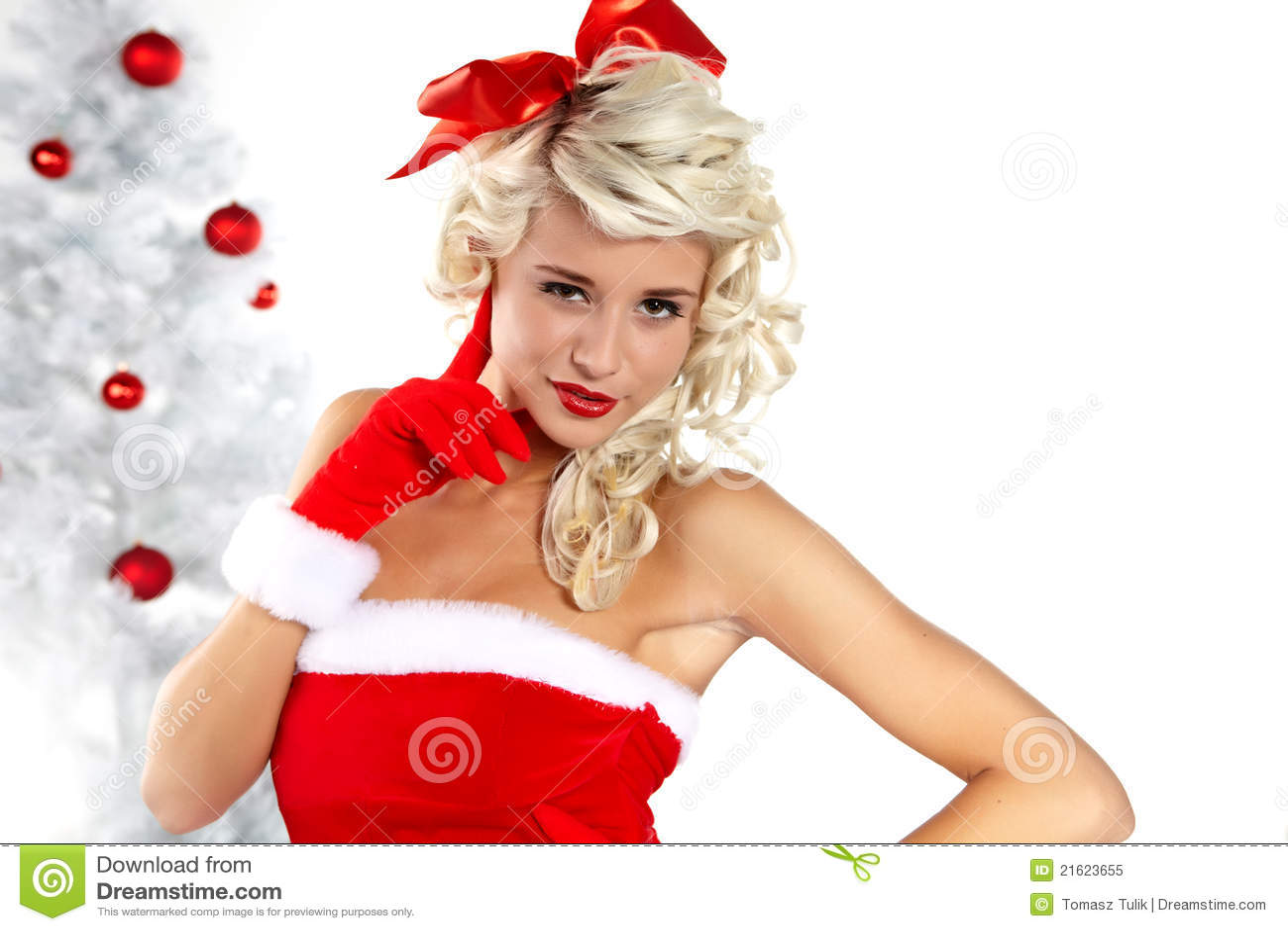 Pin Up Girl Wearing Santa Claus Clothes Stock Image