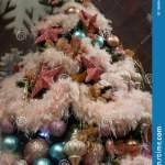 Pink Blue And Gold Richly Decorated Christmas Tree With Feather Boa And Stars Snowflakes Etc Stock Image Image Of Bears Celebrate 184594449