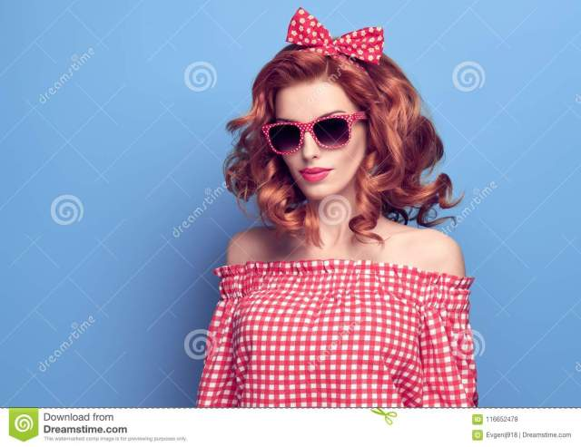 pinup beauty girl smiling. curly hairstyle. stock photo