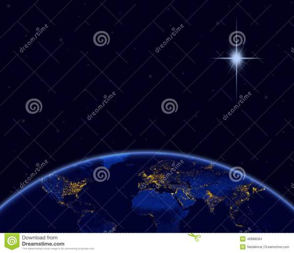 Planet Earth And Christmas Star In Night Sky Stock ...