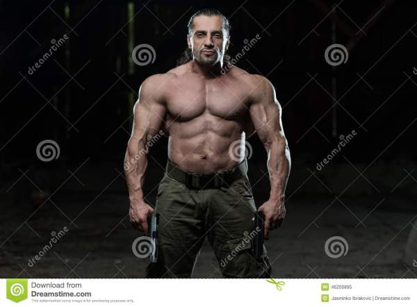 Portrait Of A Man With Guns Stock Photo - Image: 46200895