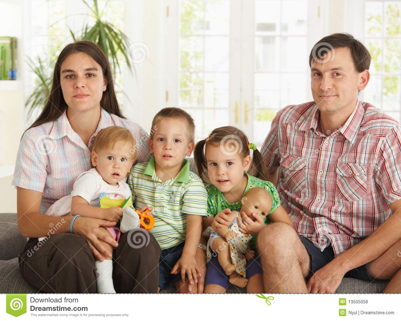 Portrait Of Nuclear Family At Home Stock Photo