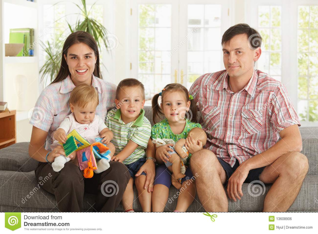 Portrait Of Nuclear Family At Home Royalty Free Stock
