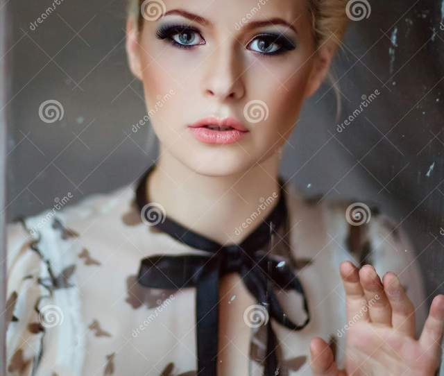 Portrait Of A Very Beautiful Sensual Girls Blonde With Smoky Ice