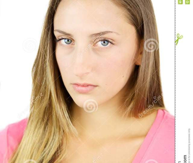 Portrait Of Young Serious Blond Teenager With Blue Eyes