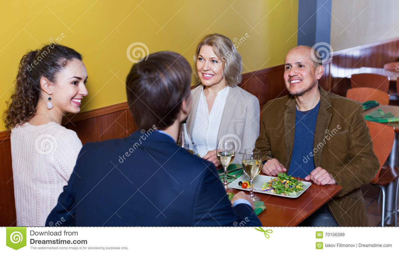 Cartoon Group People Enjoying Dinner