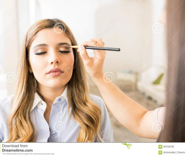 Point Of View Of A Makeup Artist Adding Some Eyeshadow To A Beautiful Female Customer In A Beauty Salon