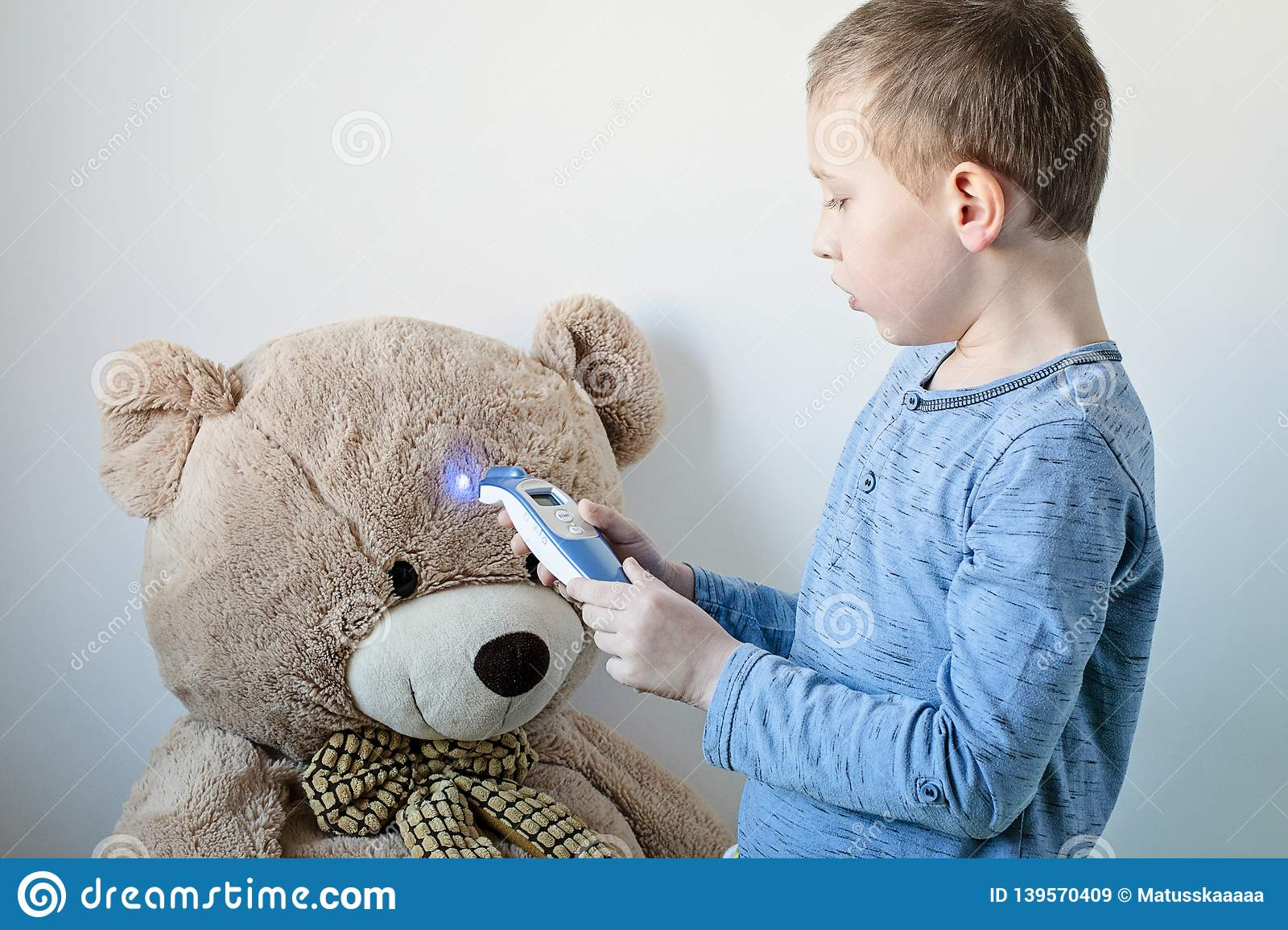 Pre School Boy Is Looking After His Sick Teddy Bear Boy