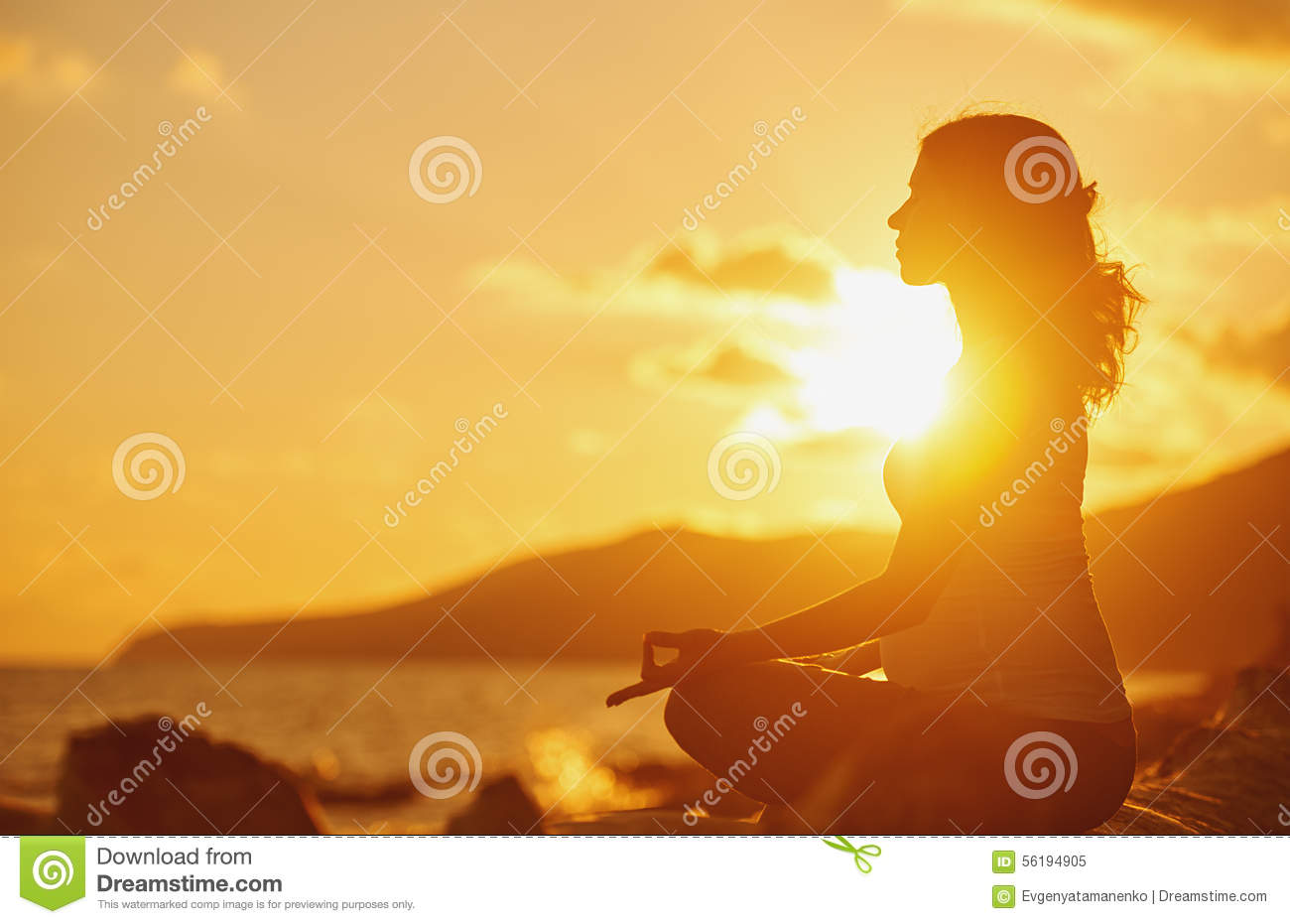 Pregnant Woman Practicing Yoga In Lotus Position On Beach