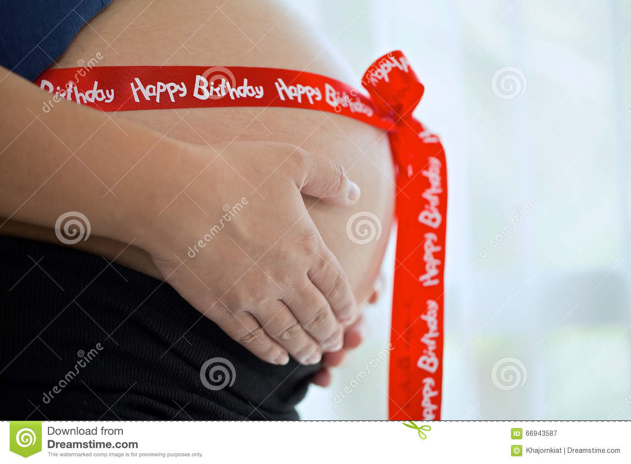 Pregnant Woman With Red Ribbon Stock Photo