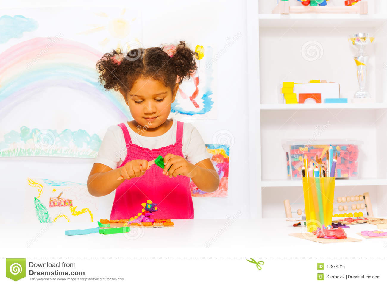 Preschool Girl Play With Modeling Clay In Class Stock
