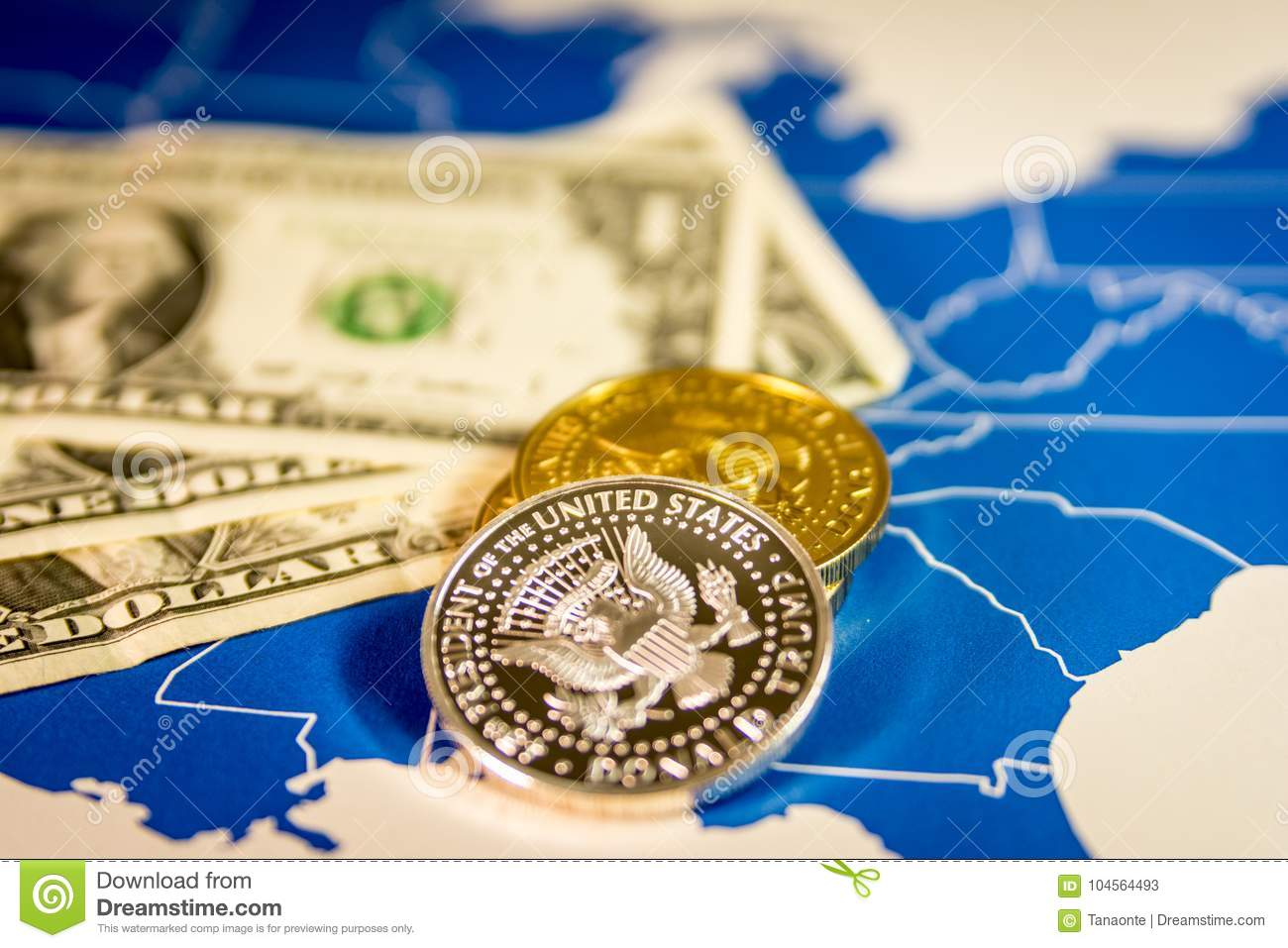 President Trump Coins And Dollar Bills Over Us Map Stock