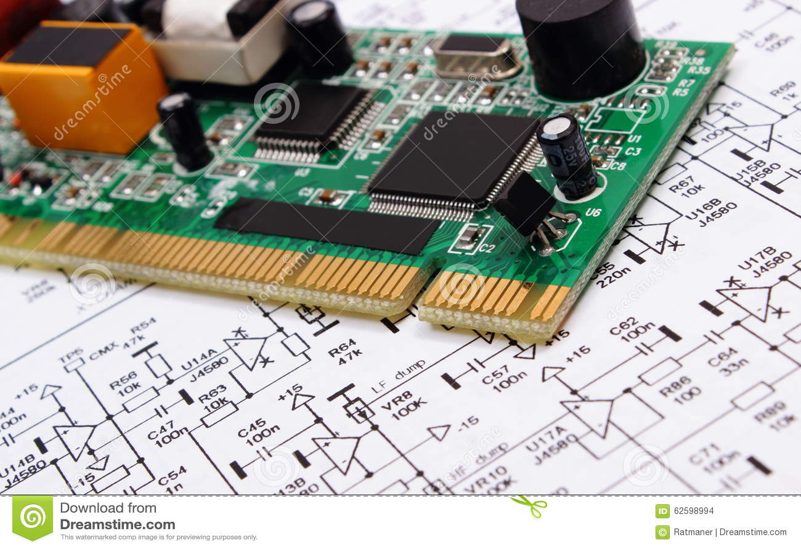 Printed Circuit Board Lying On Diagram Of Electronics