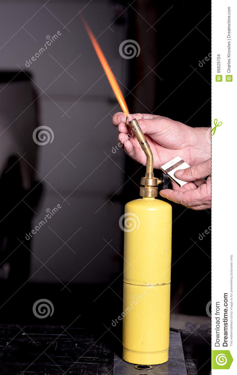 propane torch being lit by a man stock photo image of handyman torch 66629704