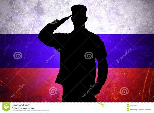 Proud Russian Soldier On Russian Flag Background Stock