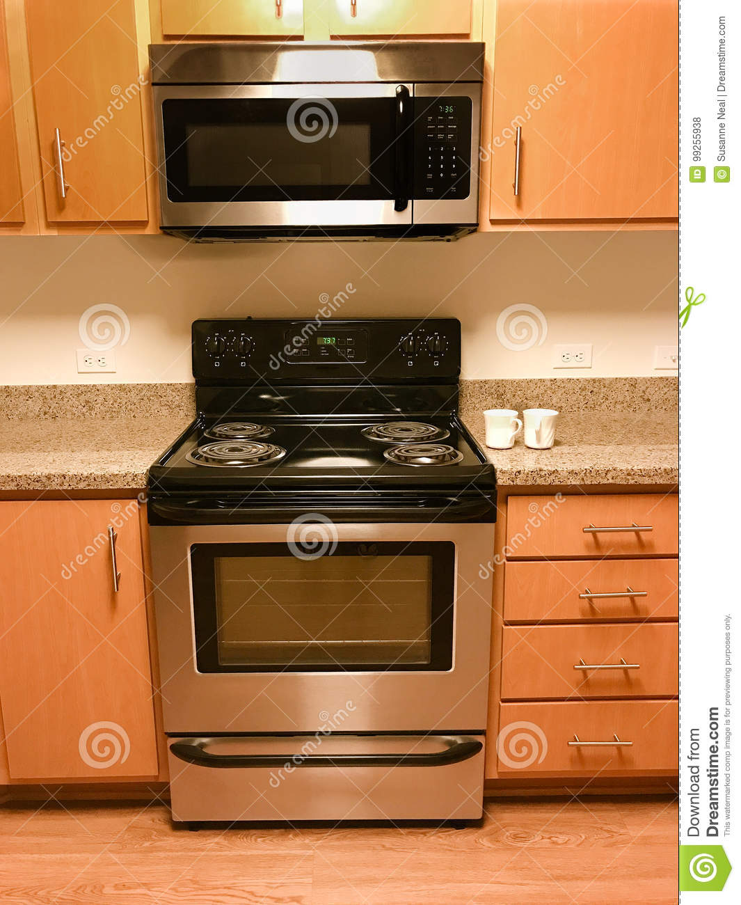 https www dreamstime com stock photo range stove microwave kitchen cabinets clean new electric range burners matching microwave oven overhead image99255938