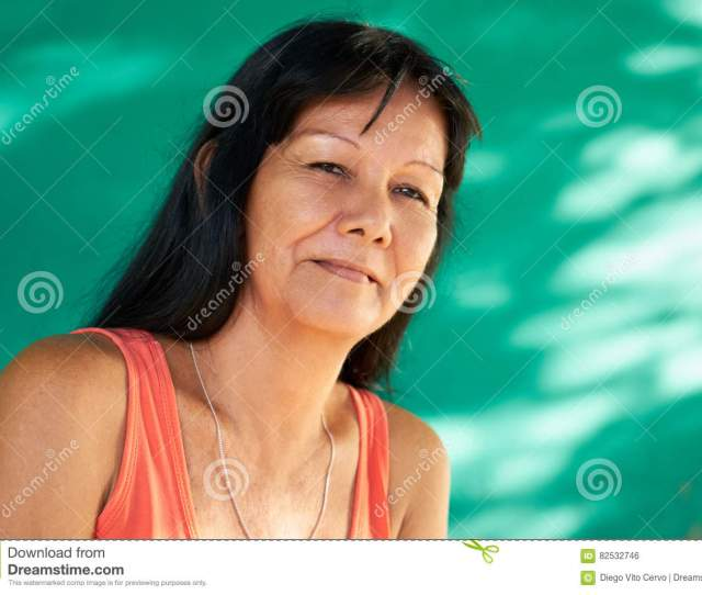 Cuban People And Emotions Portrait Of Latina Lady Smiling And Looking At Camera Happy Hispanic Woman From Havana Cuba Smiling