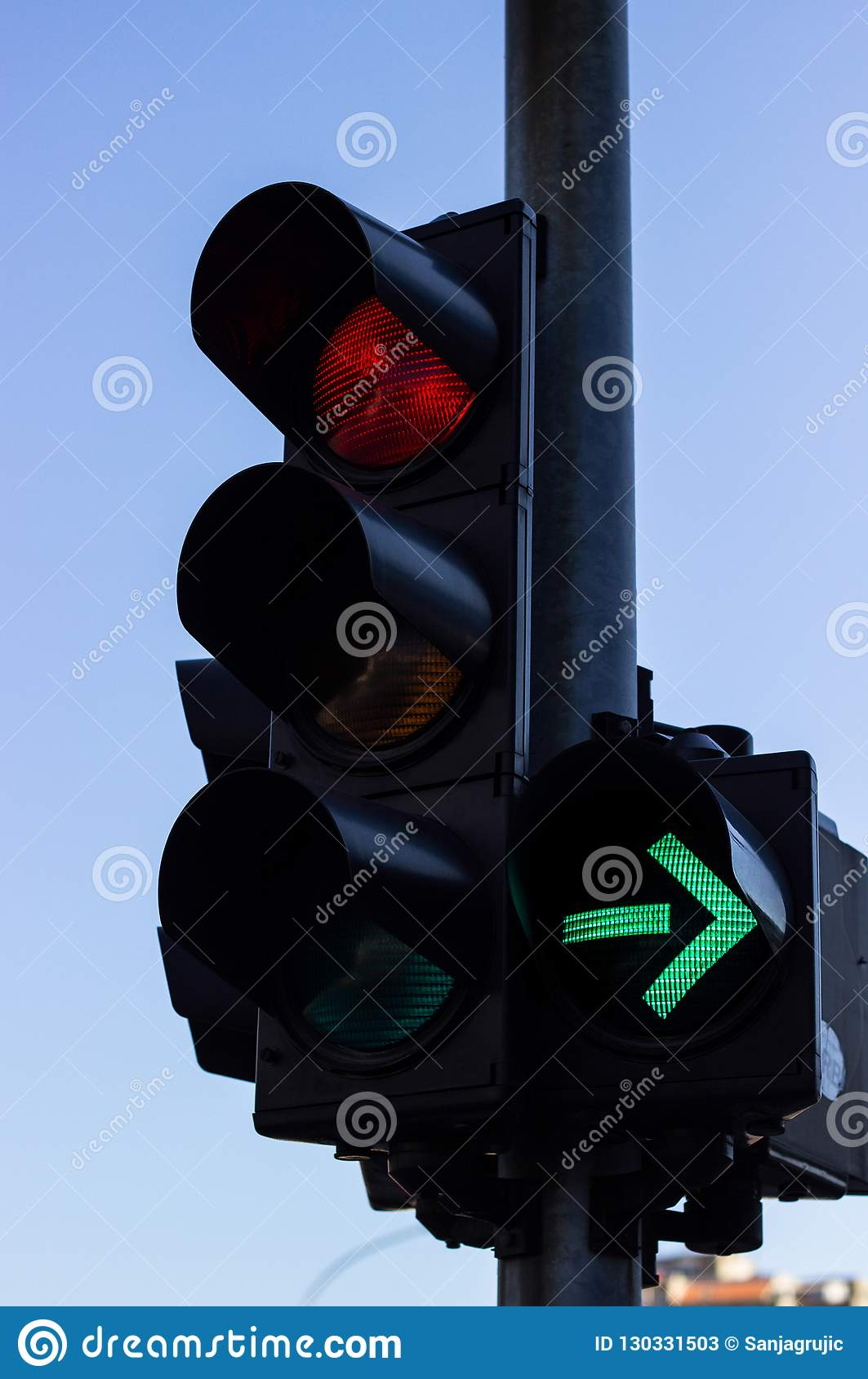 Red Color And Right Green Arrow On The Traffic Light Stock
