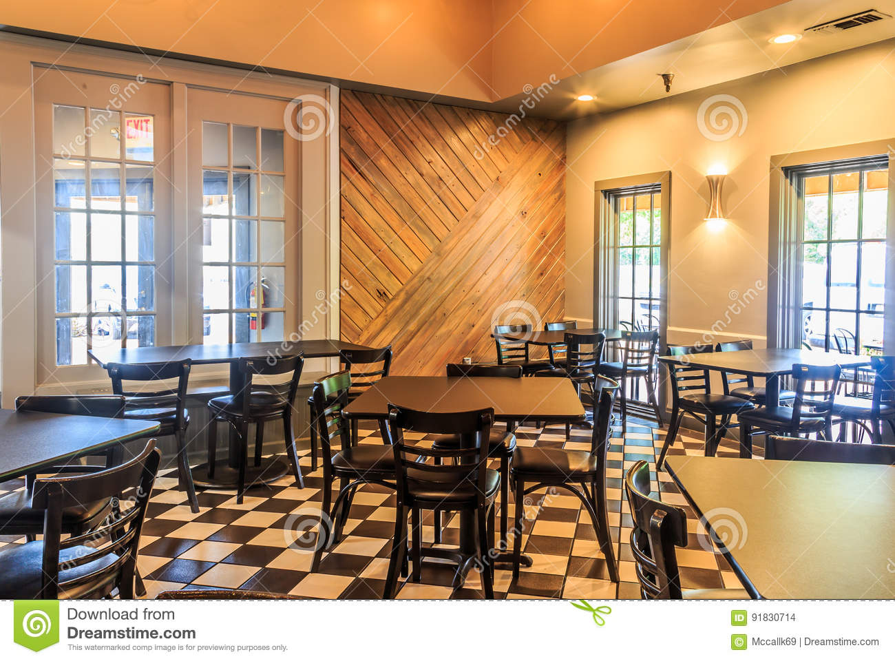 Restaurant Interior Under Warm Soft Light Stock Photo   Image of     Restaurant interior under warm soft light with a mosaic tile floor in  Montgomery Alabama