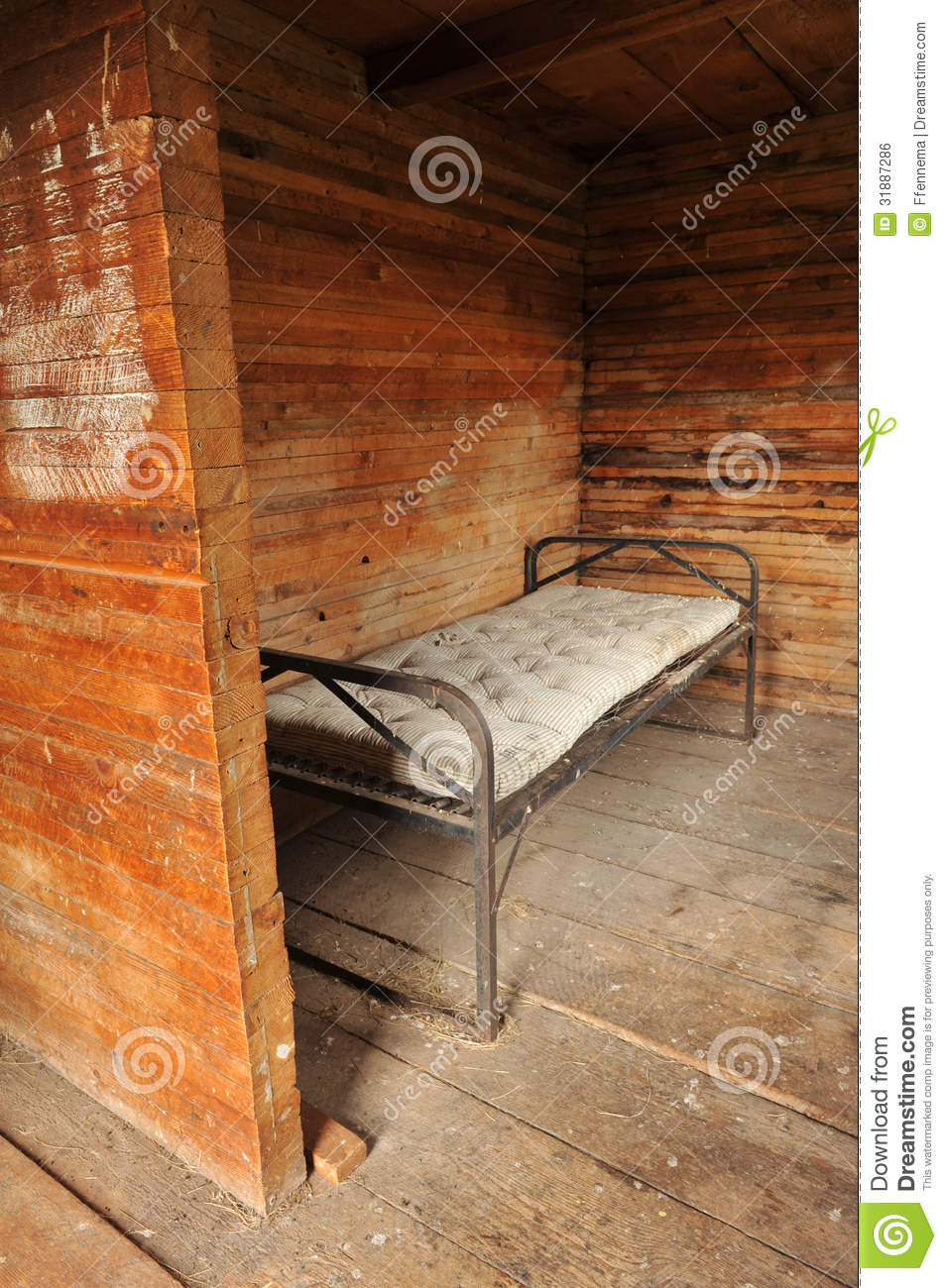 Room With A Metal Bed Frame And Old Mattress Stock Photo
