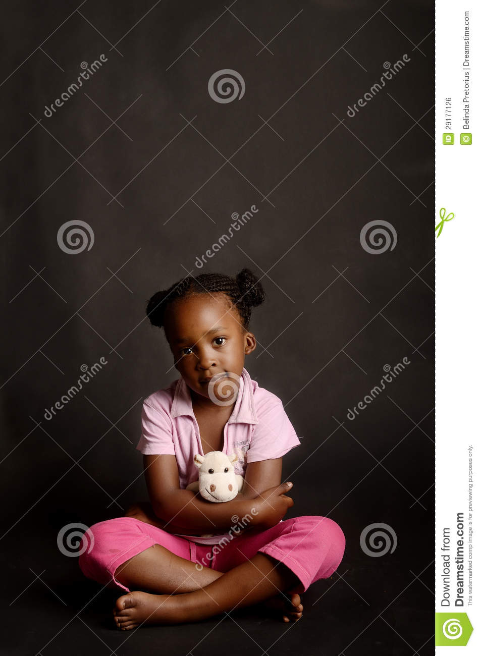 Sad African Little Girl Sitting Alone Royalty Free Stock