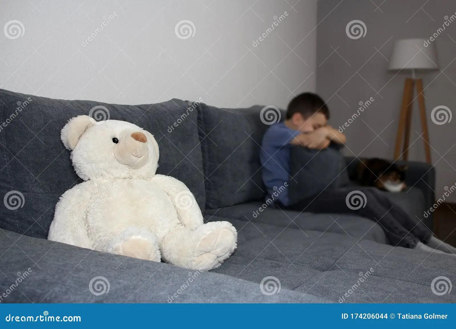 https www dreamstime com sad kid boy defocus hid his face pillow teddy polar bear focus sits couch childhood concept image174206044