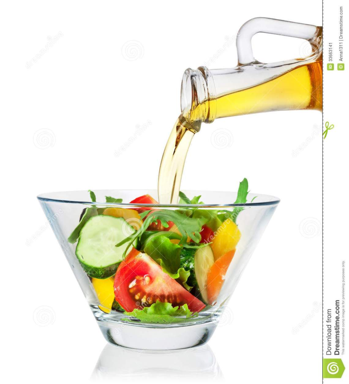 Salad With Olive Oil Pouring From A Bottle On White ...