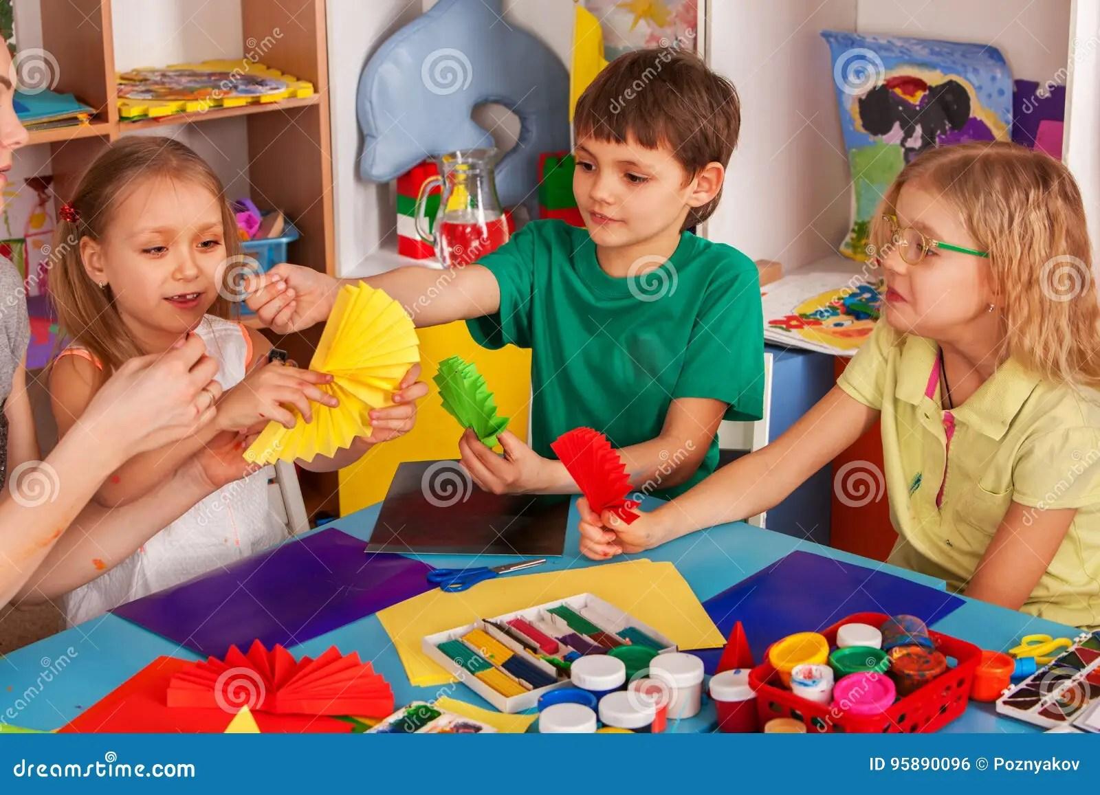School Children With Scissors In Kids Hands Cutting Paper
