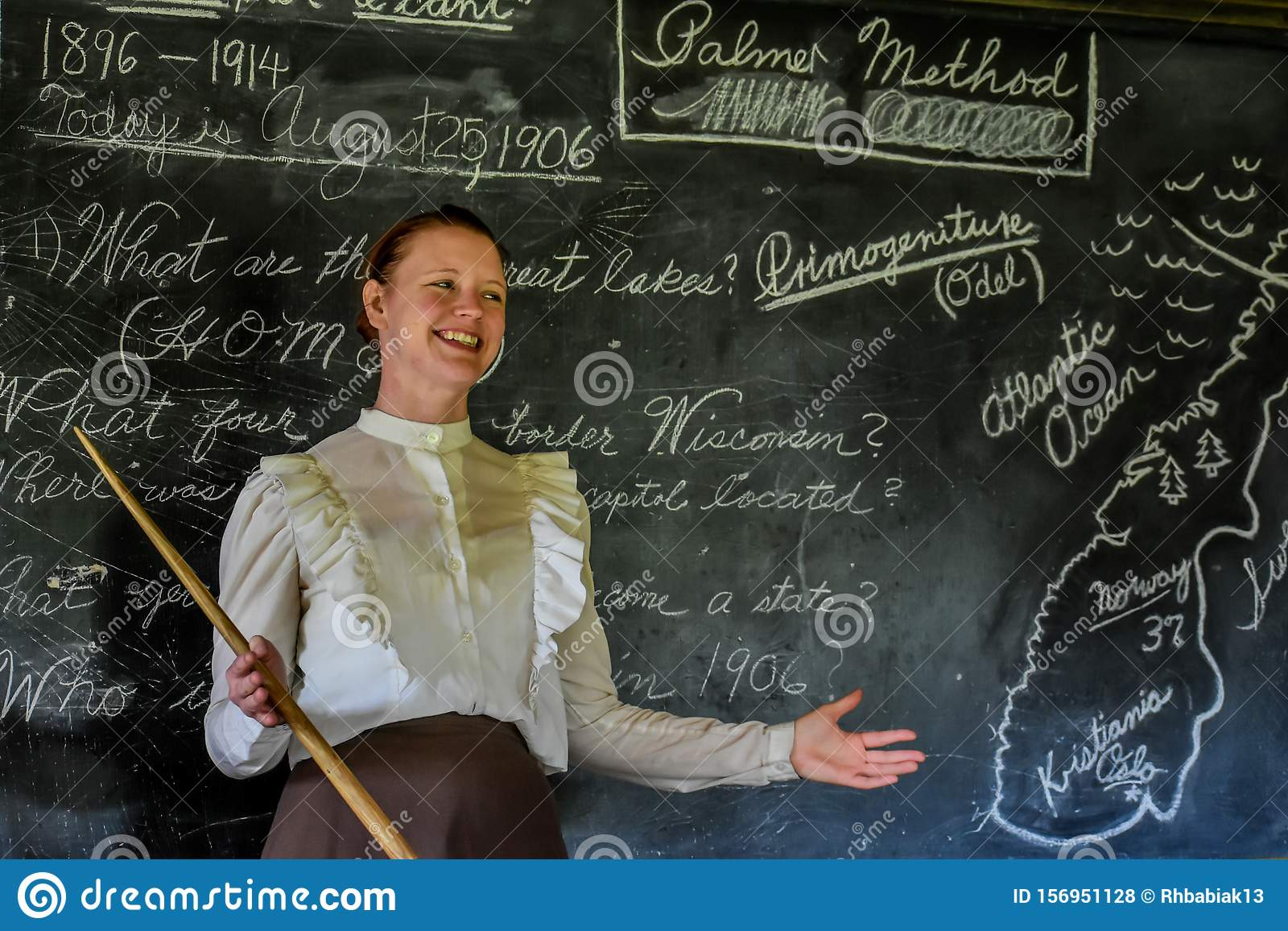 School Teacher In Front Of Blackboard Editorial Stock