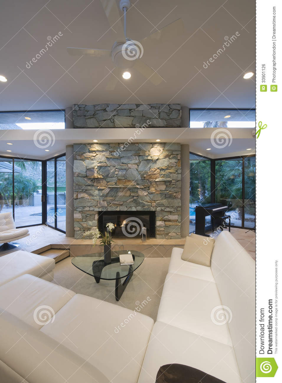 Seating Area And Stone Fireplace Royalty Free Stock Image