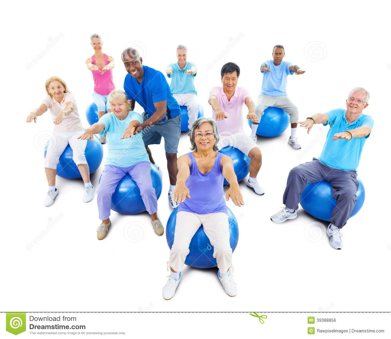 Senior Adults Exercising Yoga With The Instructor Stock Photo