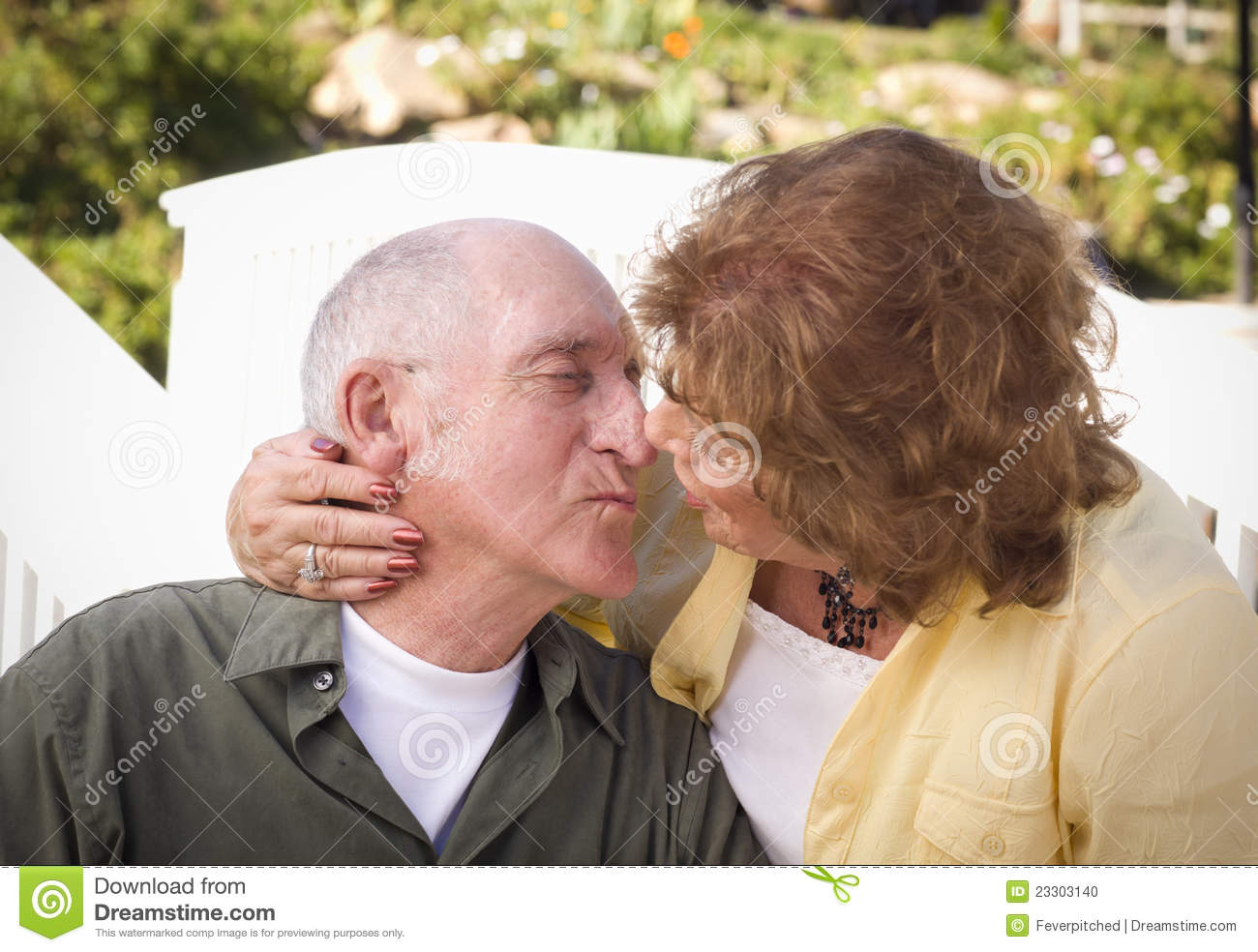 Senior Couple Kissing In The Park Stock Photo Image Of