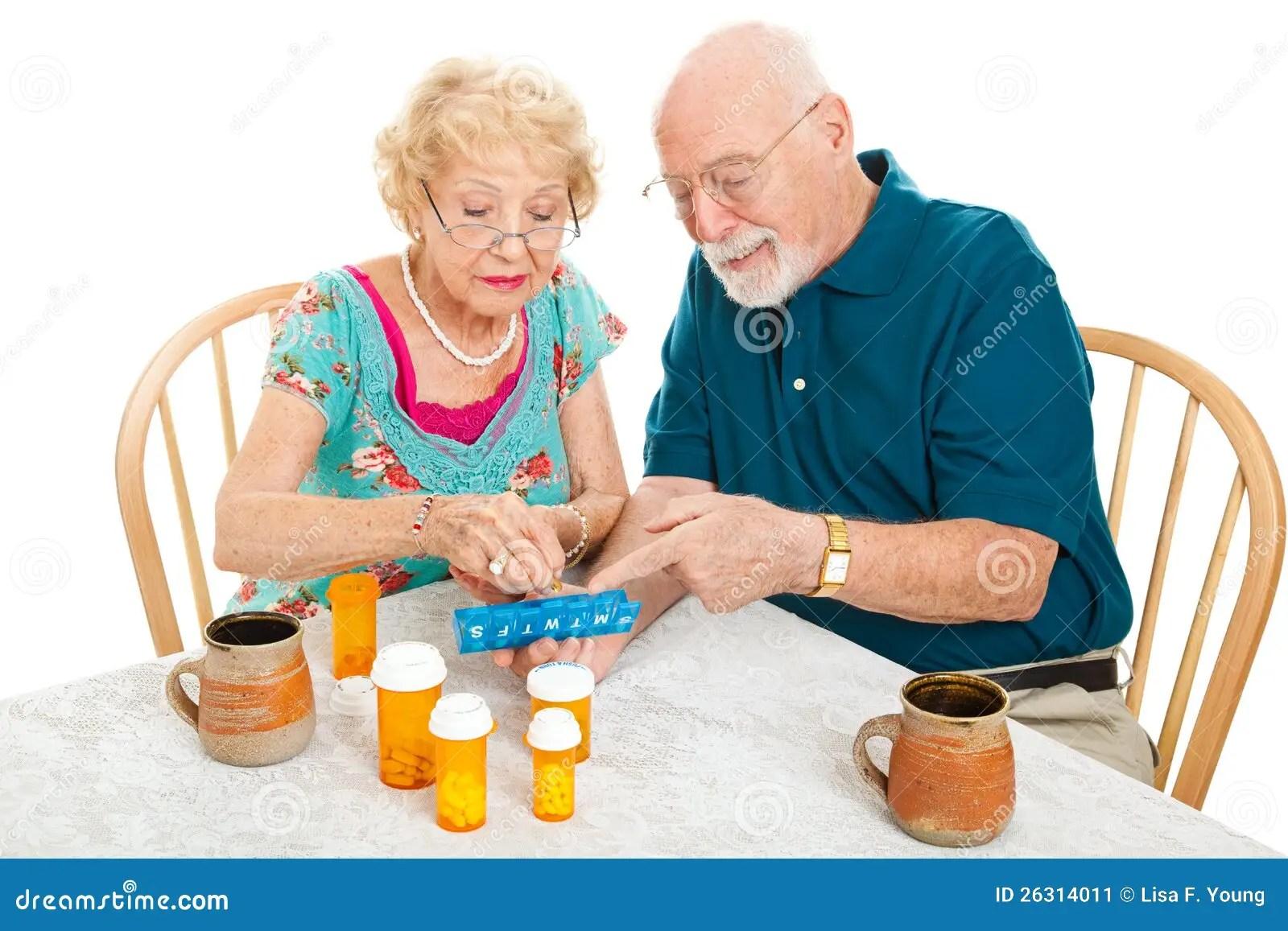 Senior Couple Sorts Medications Stock Image