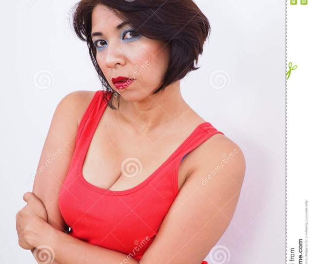 Asian Woman Isolated On White Background Reveals Nice Cleavage