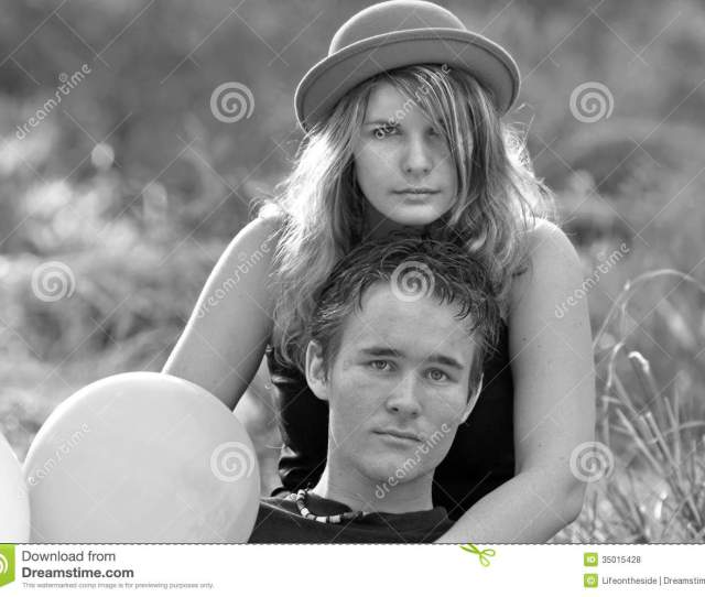 A Black And White Portrait Shot Of Two Very Stunning Looking Young People Wrapped Up In Each Others Arms The Young Women Is Wearing An Old Fashioned Bowler