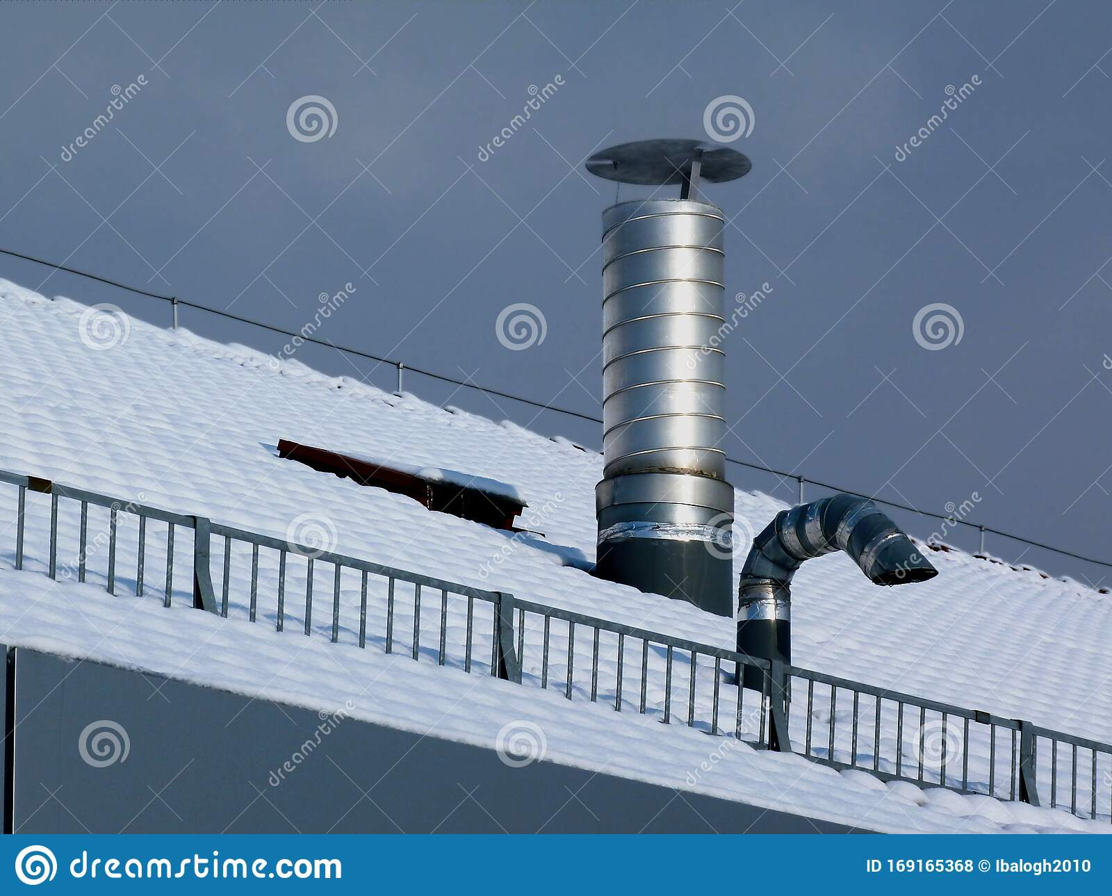 https www dreamstime com shiny aluminum roof stack vent sow covered winter roof shiny spiraled aluminum roof stack pipe cover lid exhaust image169165368