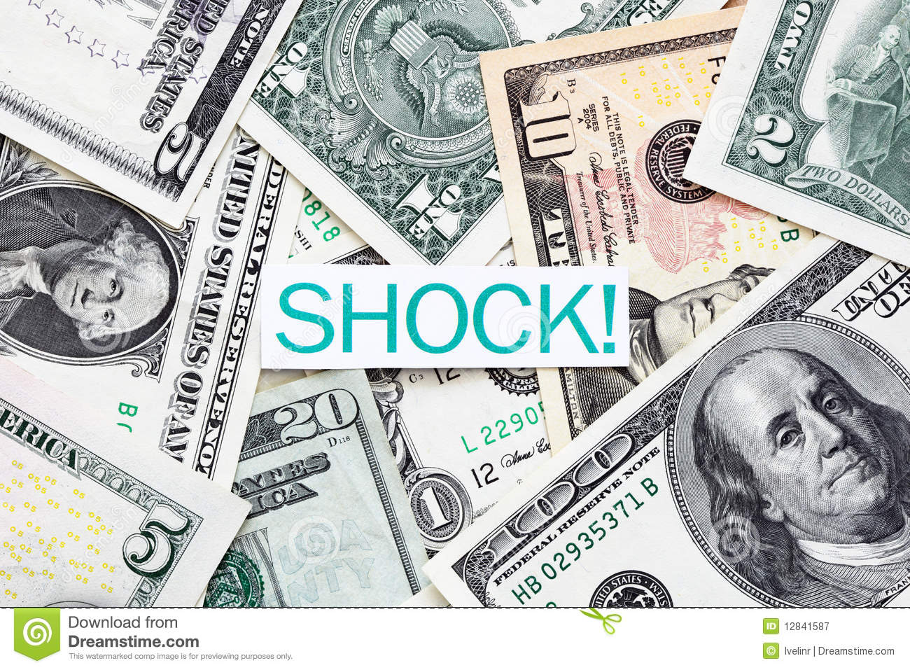 Shock Label On Us Dollar Bills Royalty Free Stock Photography