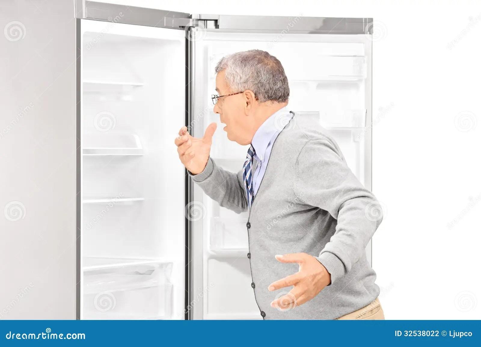 Shocked Mature Man Looking In Empty Fridge Stock