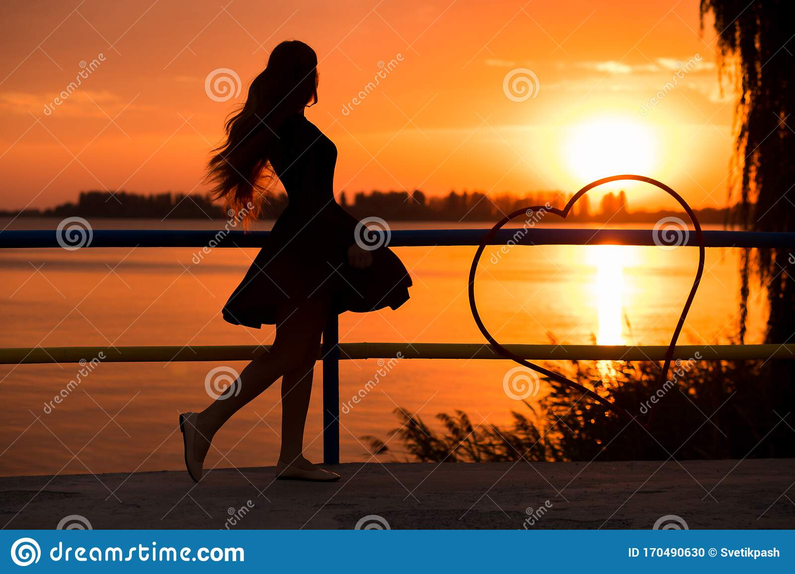 Side View Of Back Light Of A Woman Silhouette Breathing
