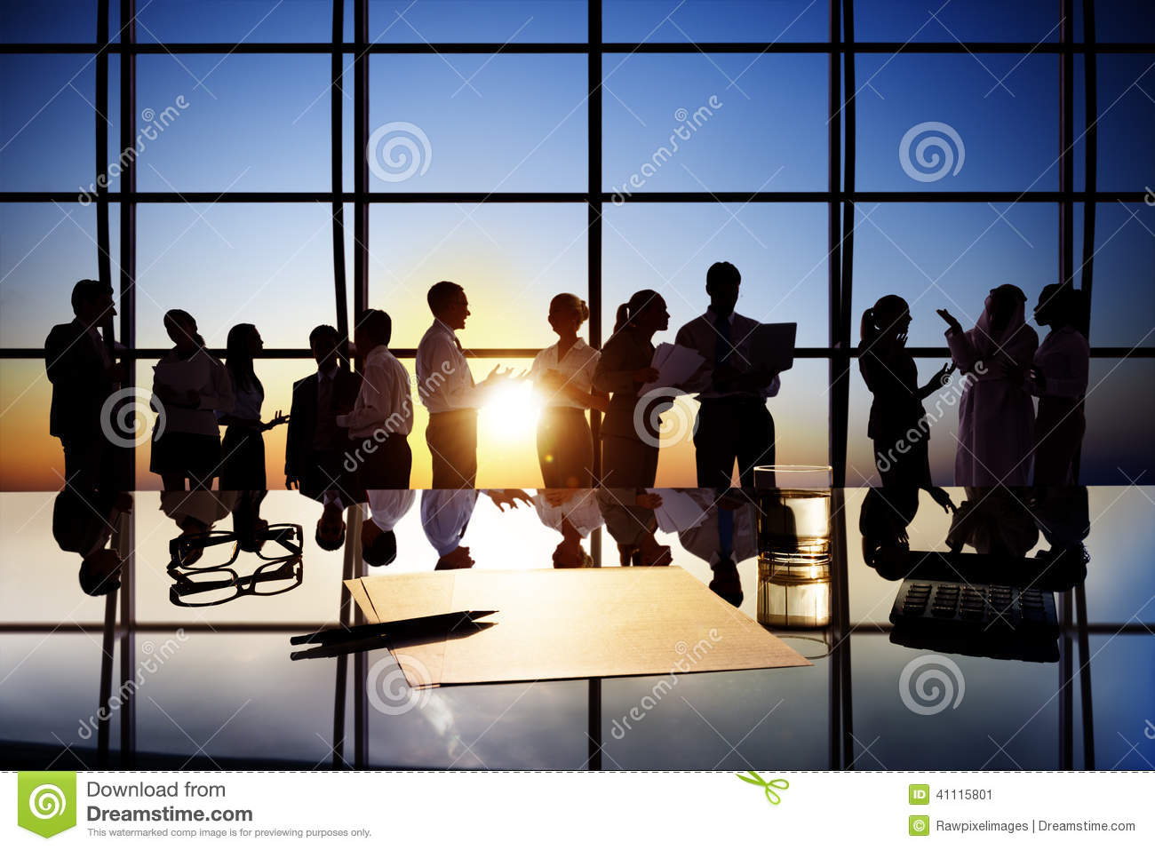 Silhouettes Of Business People Working In Board Room Stock
