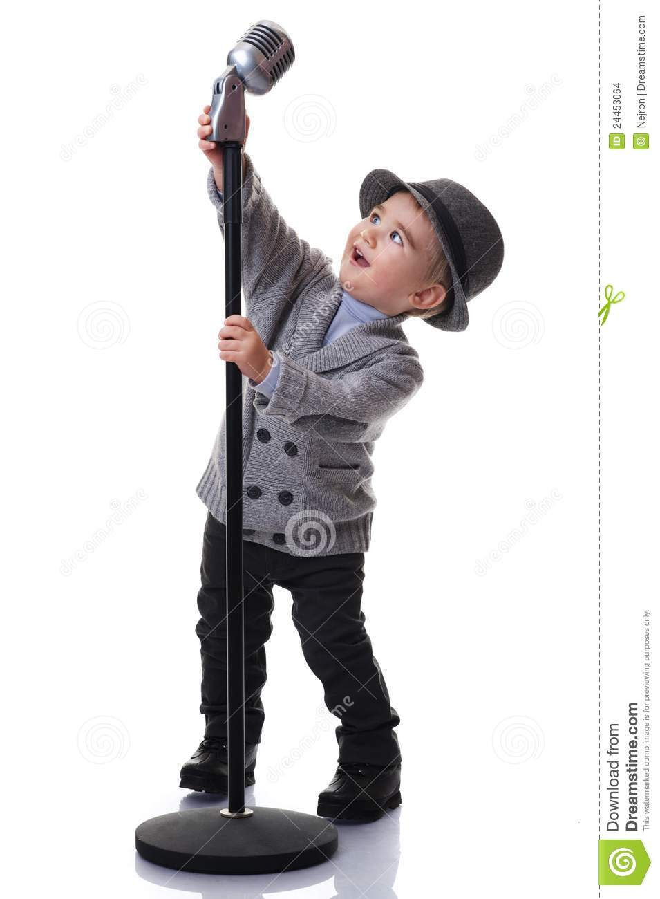 Smiling Boy Holding A Microphone Stand Stock Images