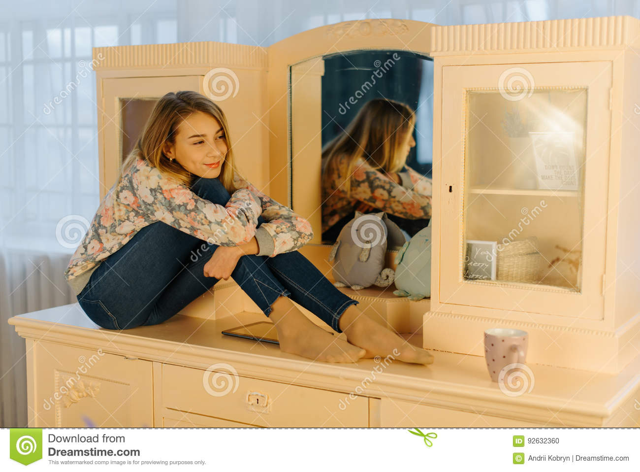 The Smiling Teenager Is Hugging Her Knees While Sitting On The Dressing Table Stock Photo Image Of Glamorous Beauty 92632360