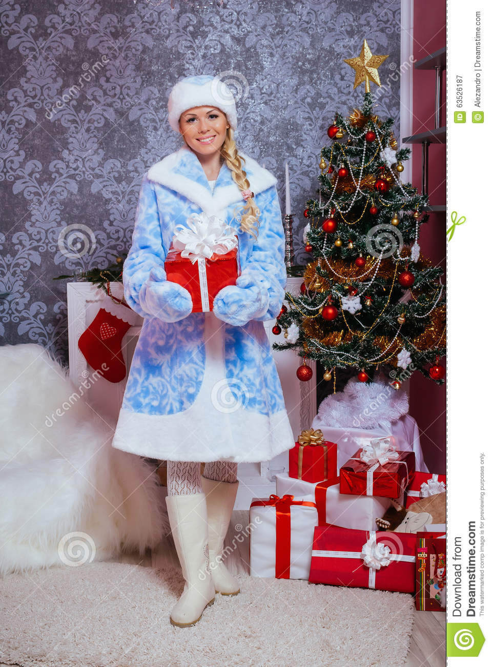 Snow Maiden Snegurochka Holding A New Year Gift Stock