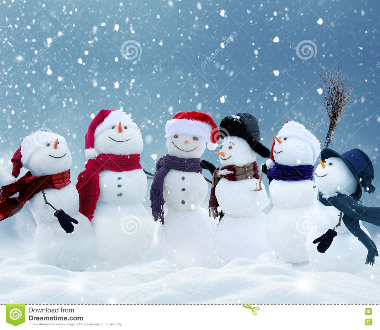 Snowmen Standing In Winter Christmas Landscape Stock Image