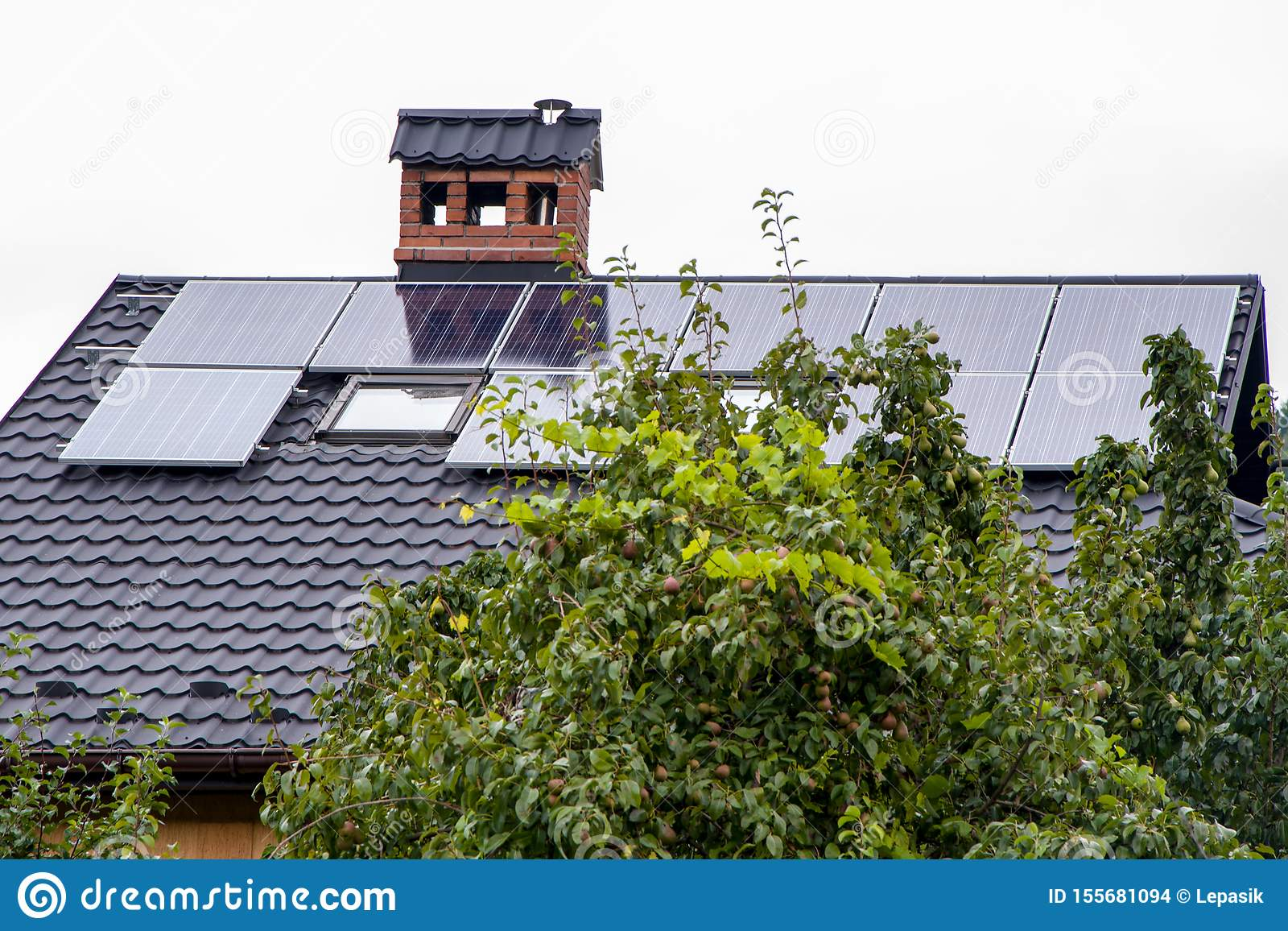 Solar Panels On The Roof Of A Country House Alternative