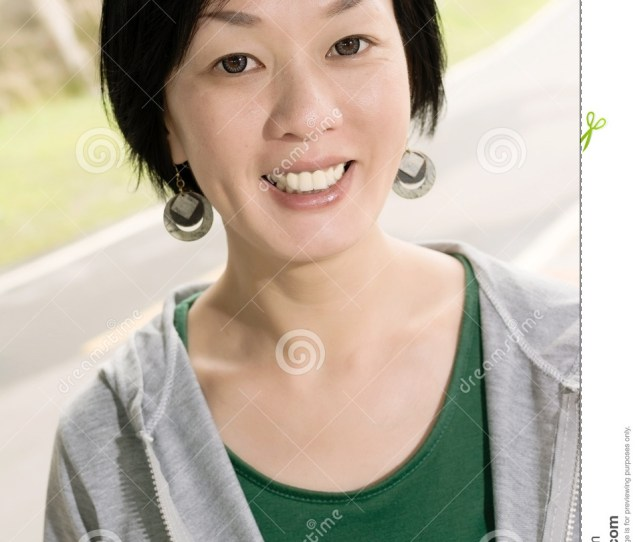 Portrait Of Sport Mature Asian Woman In Outdoor In Daytime